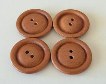 "Wood buttons, Handmade,  Mahogany, 1 1/4"" diameter."