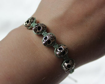 green/silver skull macrame bracelet