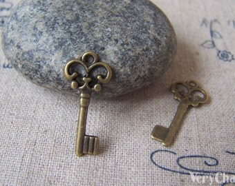20 pcs of Antique Bronze Filigree Key Charms 9x21mm A3575