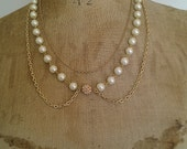 Three layered collar shaped necklace with gold chain and glass pearls with shamballa gold crystal bead centre.