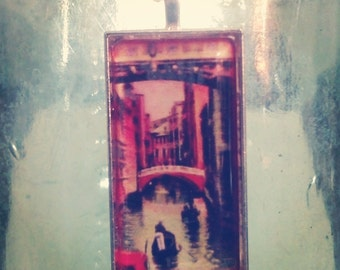 Vintage Venice postcard image of gondoliers passing under Bridge of Sighs.