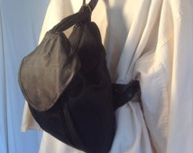 Free ship Black leather backpack shoulder bag purse sling un-used vintage 1980s