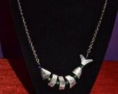 silver segmented fish necklace