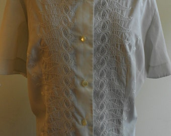 "1960's, 38"" bust, white cotton hip length eyelet , short sleeved blouse."