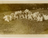 1910s Children Laying on Stomachs in Grass -  snapshot 789