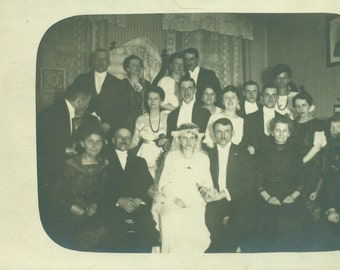 Antique Wedding Party Bride Groom With Family Guests Sitting in Parlor Vintage Black and White Photo Photograph