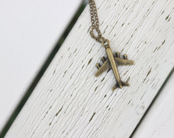 Leaving on a big jet plane, antiqued bronze airplane necklace.