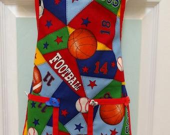 LITTLE BOY'S APRON: size 2 to 4 yrs,chef apron ,sport motif, red bias trim ,designer sport buttons