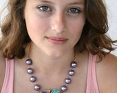 Chunky Purple Pearl Necklace with Large Gold Pendant and Purple Green and Coral Flower Cabochons