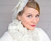 Lady Butterfly ivory birdcage veil and fascinator