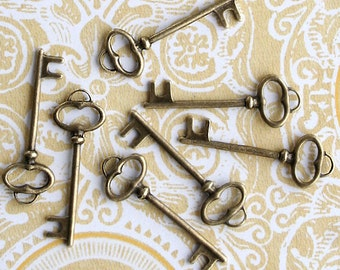 8 Key Charms Antique Bronze Tone Lovely Detail Two Sided - BC459