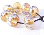 Metallic lampwork beads - set of streaky yellow mirror finish glass beads - highly reflective
