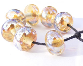 Metallic lampwork beads - set of streaky yellow mirror finish glass beads - highly reflective