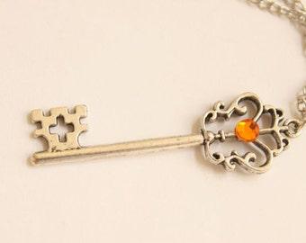 Simple Ornate Antiqued Pewter Tibetan Silver Victorian-Style Cross Design Key Necklace With Orange Tangerine Gem