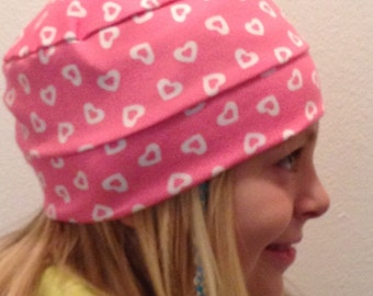 Child Tossed Hearts on Pink Hat