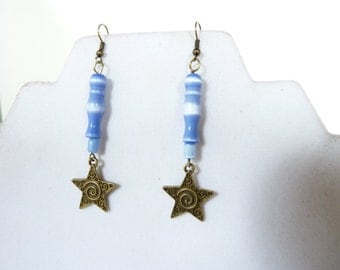 Cats eye beads in a lovely shade of blue and shiny hues, antiqued brass star, antiqued brass ear wires, soho, boho, gypsy