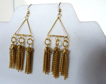 Tassels made with golden chain hang 3 x 3 on these earrings.  They are on a gold filled connector and hang from gold filled ear wires