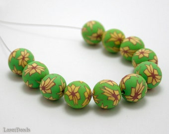 Polymer Clay Round beads 14mm (10) Light Green with Yellow Flower