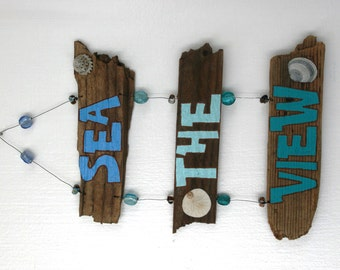 Sea the View Driftwood Art with colorful beads and shells