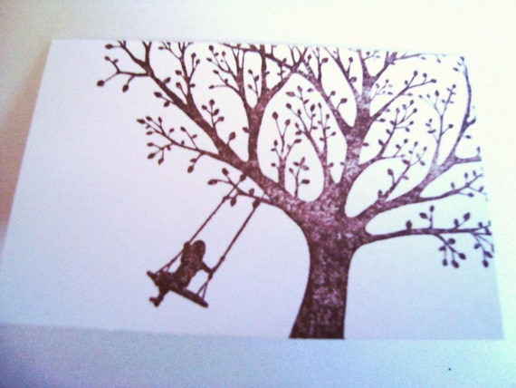 Girl Swinging On A Hand Girl on a tree swing