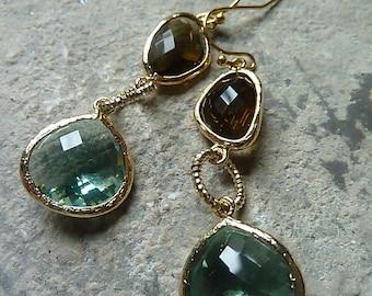 Topaz and ernite crystal dangle earrings in gold.