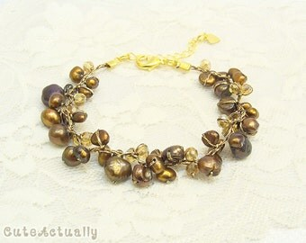 Brown freshwater pearl bracelet with crystal on silk thread, bronze