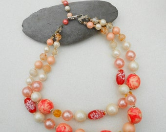 Vintage beaded necklace in peach and oranges awesome mixture of beads vintage 1950s jewelry