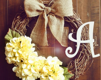 Monogrammed Yellow Hydrangea Grapevine Wreath with a Burlap Bow.