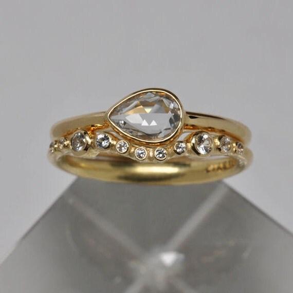 white pear cut sapphire engagement by onestonenewyork
