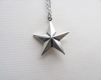 Silver star charm necklace on delicate sterling silver plated chain