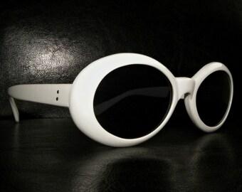 Unworn vintage 90s retro 60's white round frame Sunglasses Kurt Cobain Nirvana Mod Kitsch grunge shades 80s black arms mens womens rocker