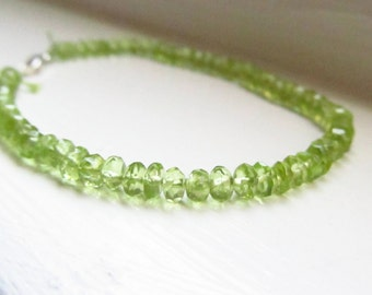 Peridot bracelet August birthstone green silk thread silver gold drape stacking