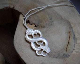 Mother of pearl shell maori manaia pendant on white cord