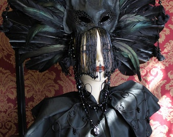 The Familiar - Shaman headdress of feathers, leather cat mask and glass jet beading.