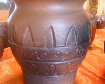Smoke fired pot, carved, burnished, earthy.