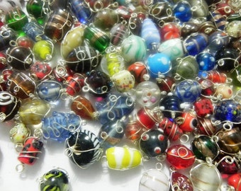 1 pound  WIRE WRAPPED silver finish wire  glass beads handwired.