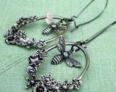Chasing Flowers: antiqued silver and gunmetal floral elongated hoop and honey bee earrings