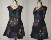 Black Cotton Jersey Spring Dress with bronze metallic boar skulls, teal feathers,  purple firework shells screenprinted