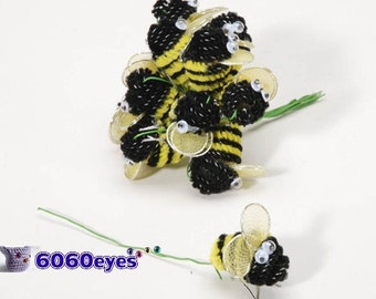 Yellow and black chenille bees