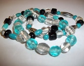 Turquoise, black, silver and clear beaded elastic bracelet.