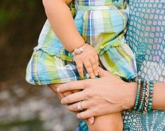 Baby Puka Shell Hawaiian Bangle. Sterling Silver