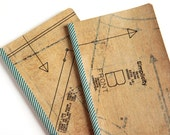 large moleskine cahiers notebook or journal with lined pages and sewing pattern collage, stitch and sew (imperfect)