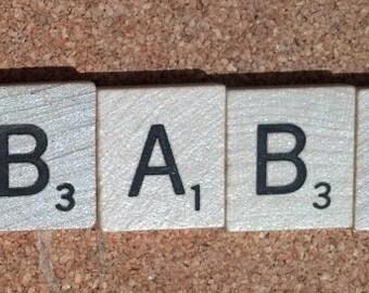 Four Scrabble Tiles