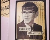 Curiously Attractive greeting card