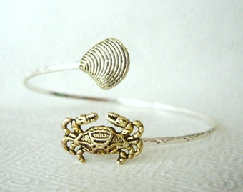 Silver crab bracelet with a shell, wrap style