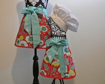 Mother/Daughter Red Flower Half Aprons Trimmed in Teal with Pockets
