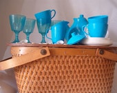 Vintage Child's miniature orange  wicker picnic basket with lid, swing handles, and plastic tea set