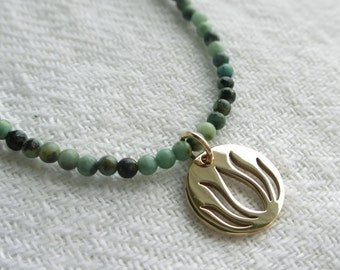 Brahma Necklace - Gold Lotus Charm and African Turquoise Beads