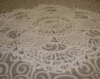 Hand crocheted scalloped edge doily