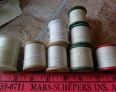 8 Vintage Buttonhole and/or carpet spools of thread by various makers in assorted Whites